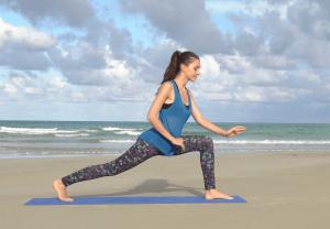 videoblocks-girl-practices-yoga-near-the-ocean-sea_switrqig_thumbnail-full01