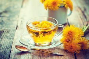 cup-of-healthy-dandelion-tea-herbal-medicine-retro-royalty-free-image-539117696-1538487191